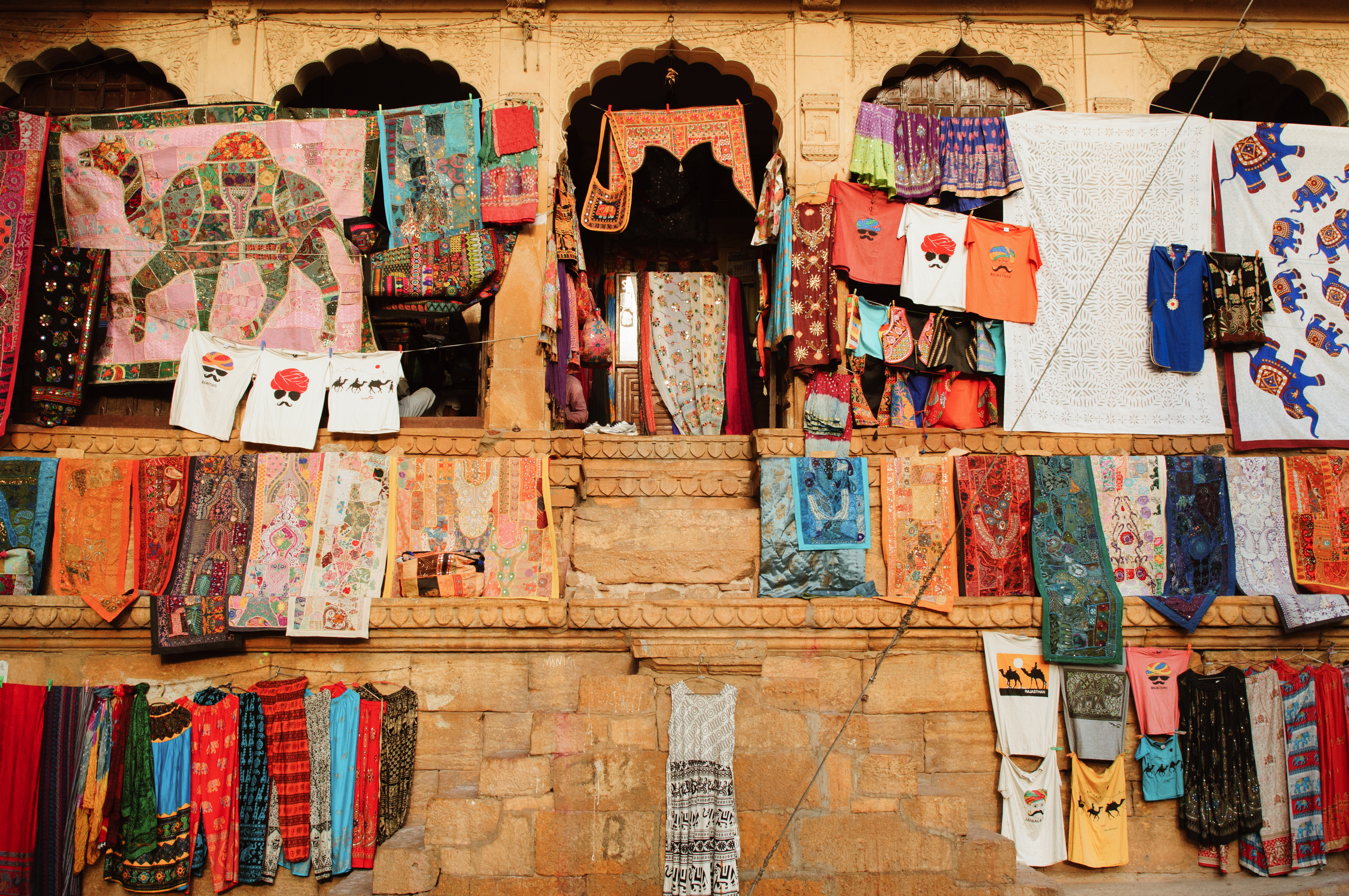 hanged assorted-color-and-print textiles
